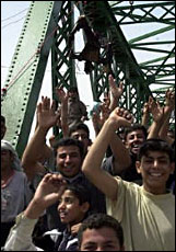 Fruit of Islam rejoicing regarding dead burnt American body in background